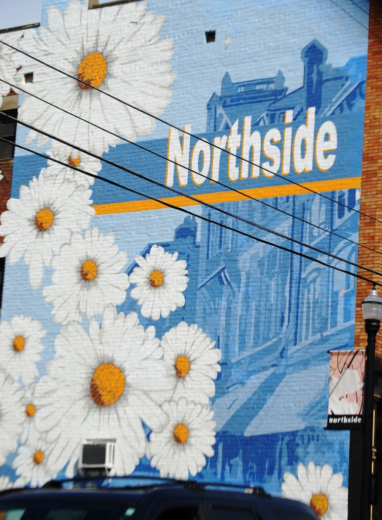 Large Mural on side of building representing the Northside district