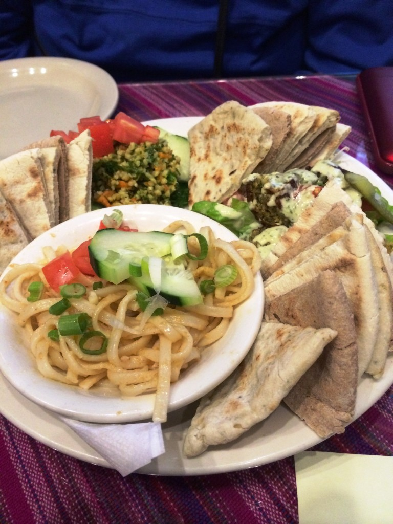 My meal at Myra's Dionysus - a pesto fettucine, some bread and hummus.