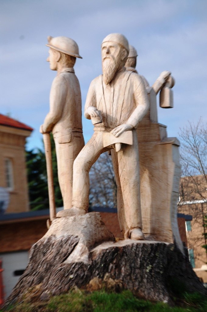 Wood Carving of Iron Workers in front of Ironwood Station in Ironwood, MI