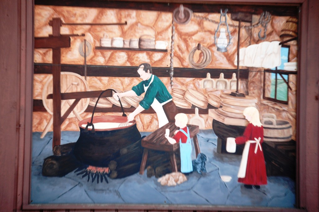 One of the two murals that decorate the outside of Ellenbach's Cheese Chalet