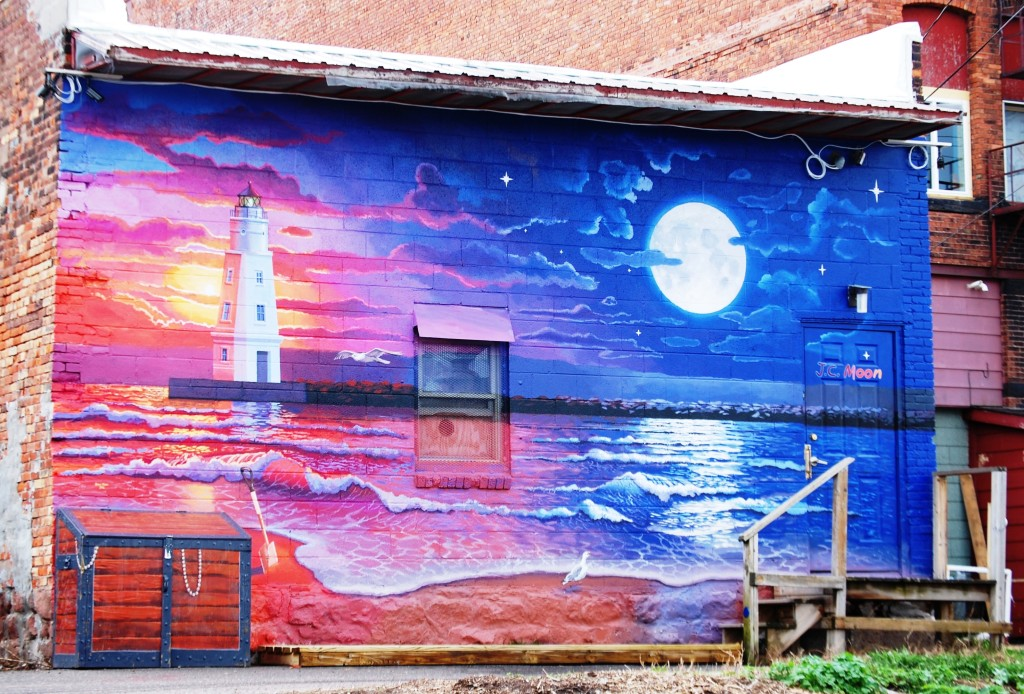 Unknown mural on the back of a building in an alley in Ashland, WI