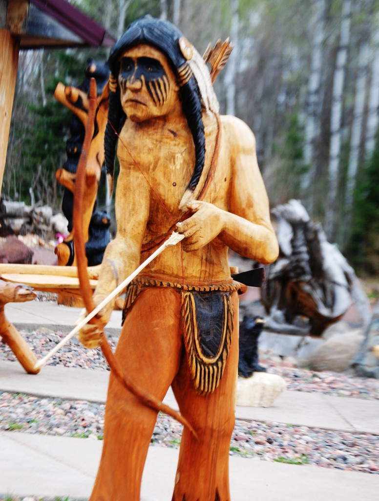 A carving of an Indian at Grizz Works