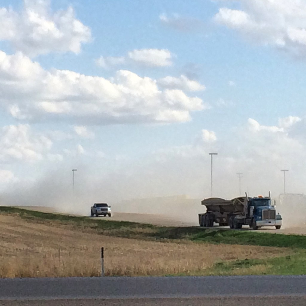 Typical scene in Williston - trucks cruising down dusty dirt roads from the drilling fields