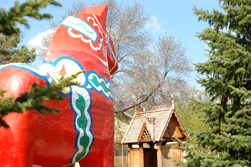 Dala Horse and one of many buildings at the Scandinavian Cultural Heritage Park