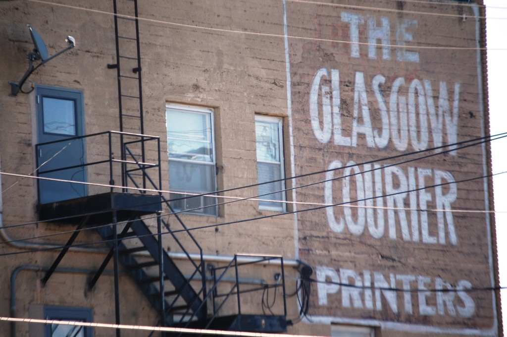 Old Glasgow Courier sign on a building