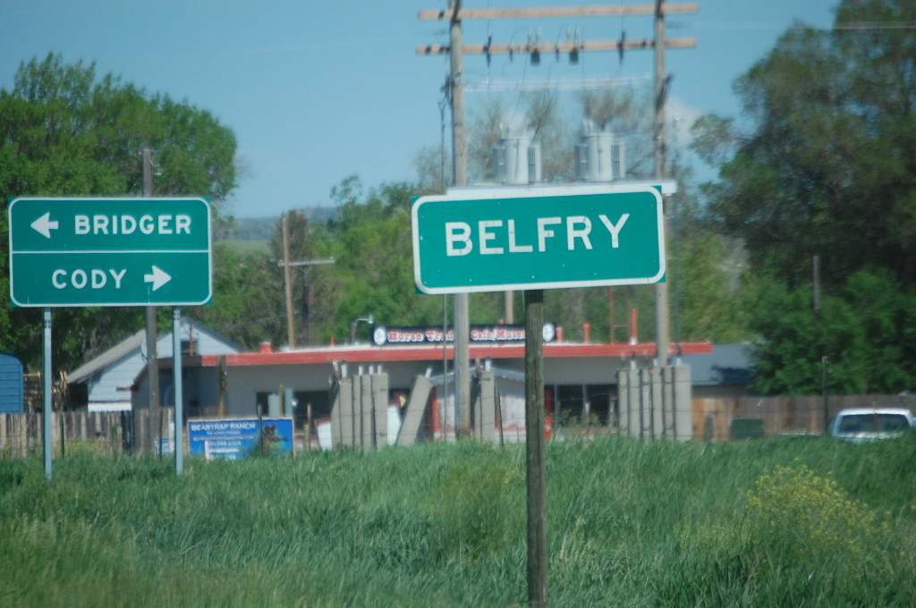 Belfry, Montana with sign to Cody, Wyoming in background