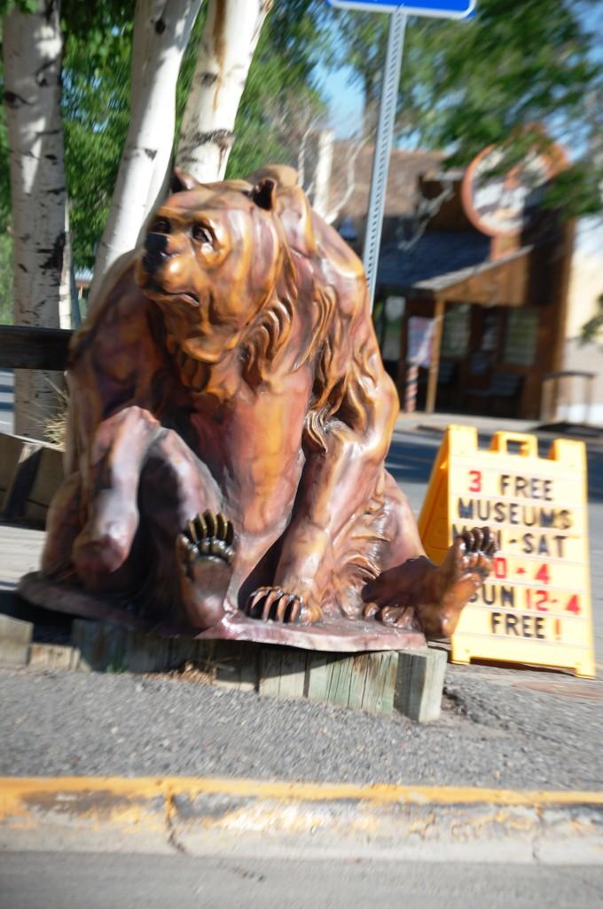 A cuddly bear on a corner in Meeteetse, WY