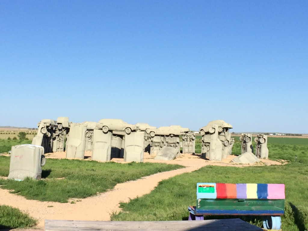 Carhenge as seen from the Gift Shop. The colorful bench is also made from car parts