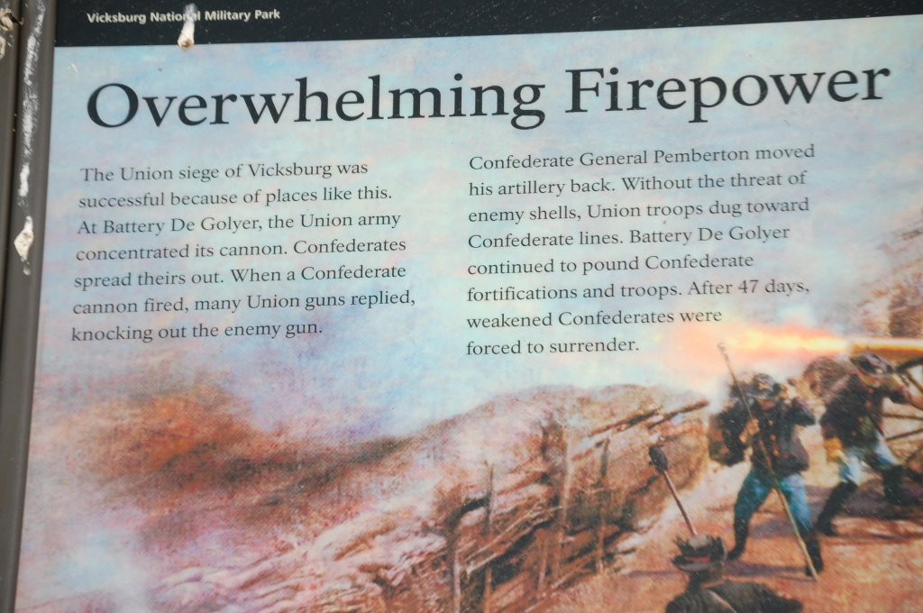 A plaque explains the firepower of the cannons