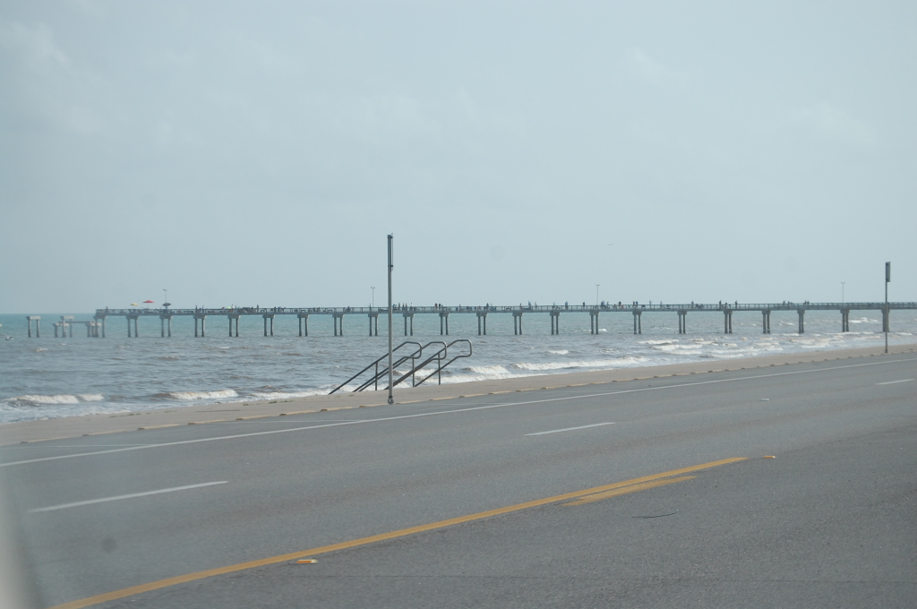 Drive along the Seawall Highway on Galveston Island