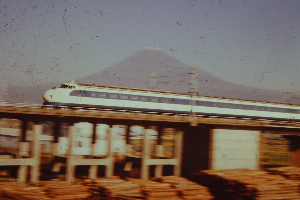 A Bullet Train speeds by with Mt. Fuji in the background (ca. 1978)