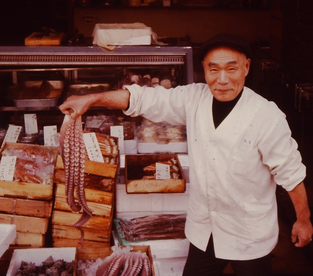 A fish monger with an octopus in Takaoka, Japan (ca. 1977)