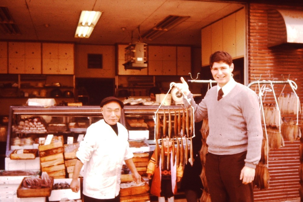 Hanging with the fish monger and holding dried squid in Takaoka, Japan (ca. 1977)