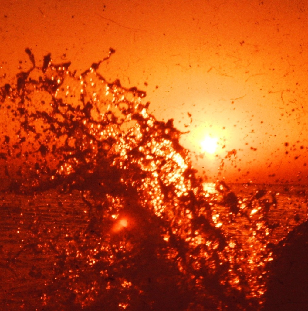 A wave splashes at sunset on the coast of the Japan Sea near Fukui (ca. 1977)