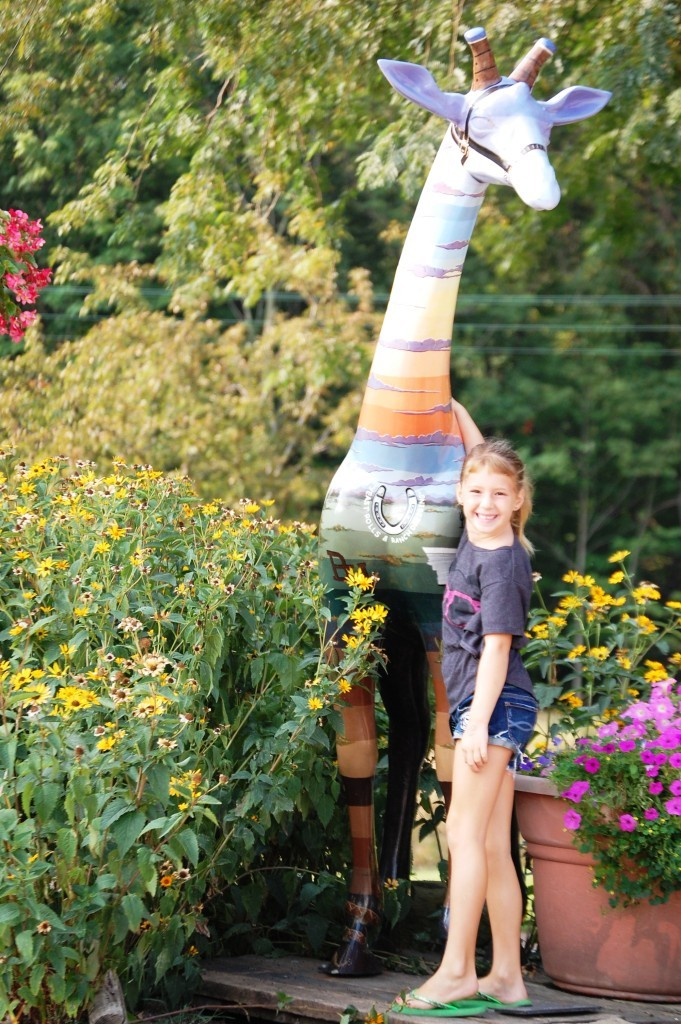 A colorful giraffe (with granddaughter) in Covington, IN