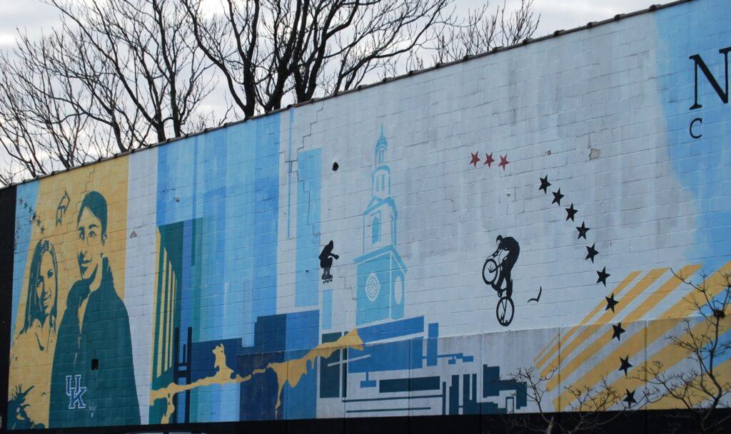 The left side of the huge Newtown Crossing wall mural in a neighborhood just off  of the UK Campus
