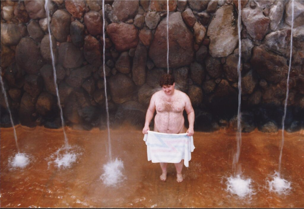 A hot spring shower in Beppu...and yes, the towel was necessary.  1990