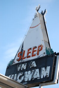 Sleep in a Wigwam neon sign in Cave City, KY