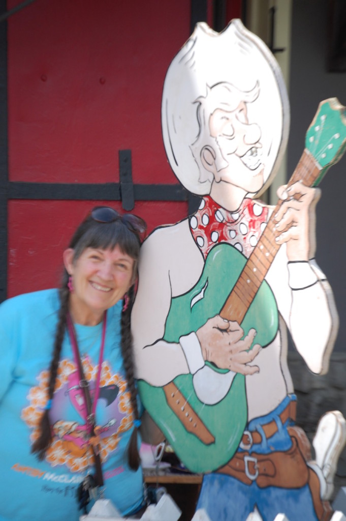 """""""Christmas"""" Carla (her birthday is on Christmas) poses with a singing cowboy in Upper Lake as we think about Antsy McClain"""