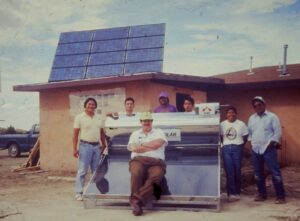 Setting up solar water heater on Hopi Reservation in 1990