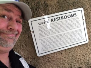 """The sign talking about """"Weird Restrooms"""""""