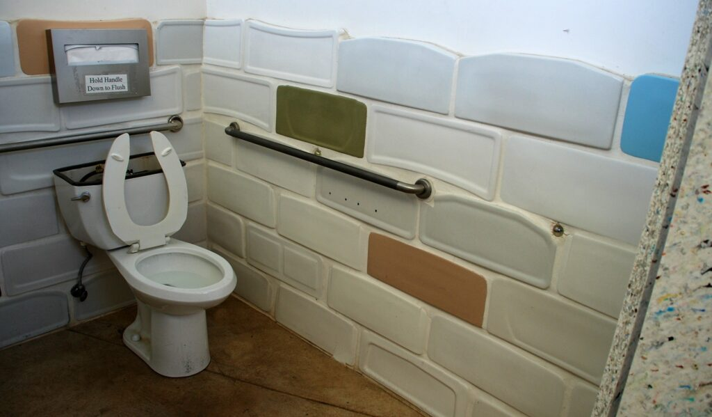 "The ""weird part"" is the recycled toilet tank lids that cover the wall.  Other recycled items can be found within as well."