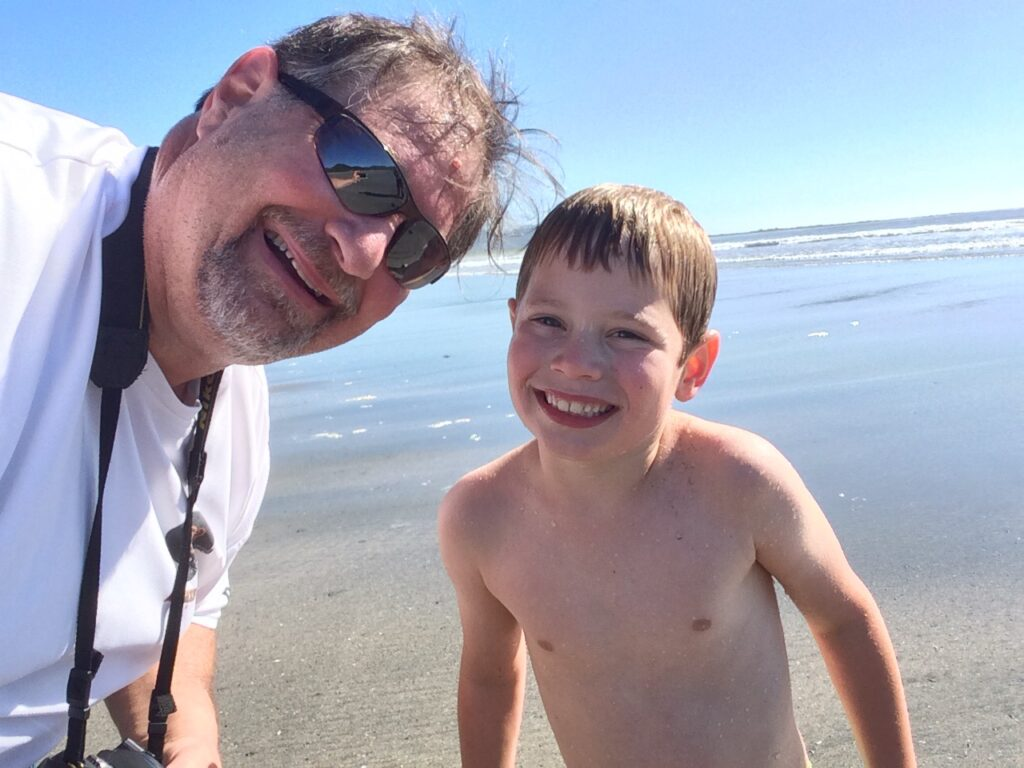Grampz with grandson Charles on the beach in Neah Bay, WA