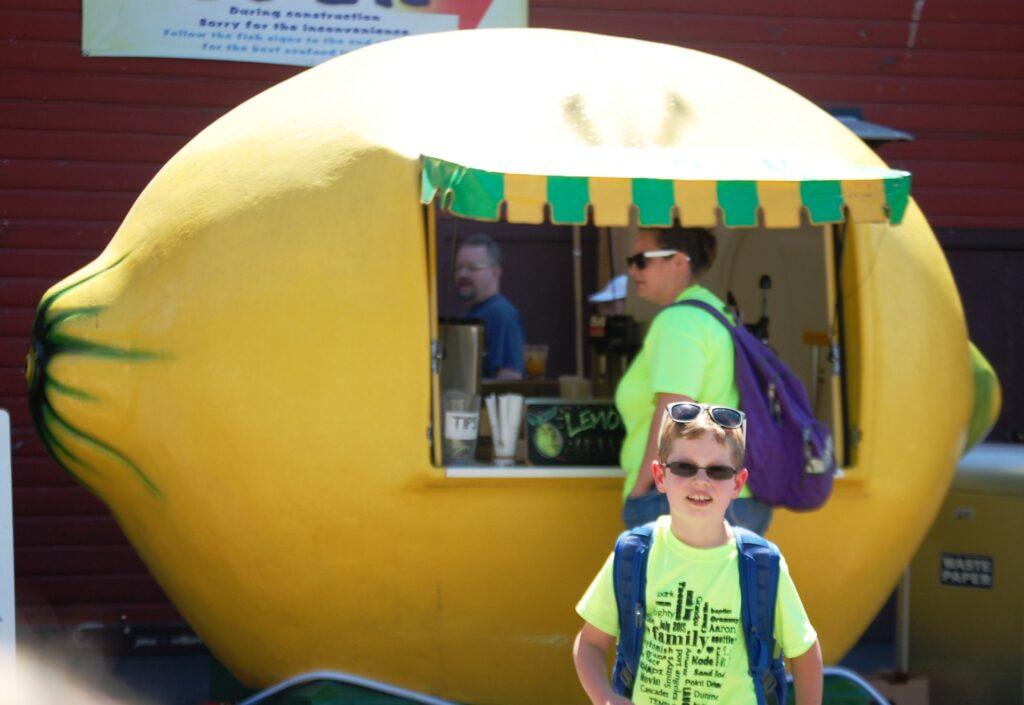 Amaree gets lemonade at a real lemon stand