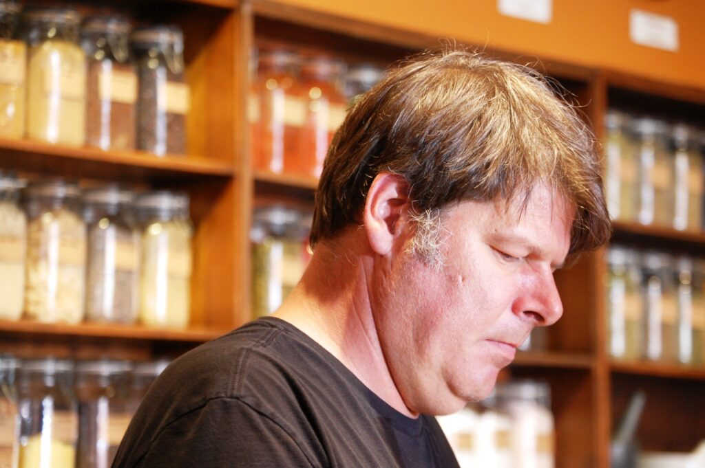 One of the World Spice Market staff prepares spice mix