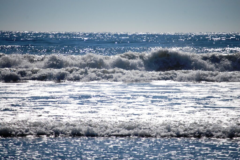 The waves of the Pacific Ocean crash into the lovely sandy Hobart Beach