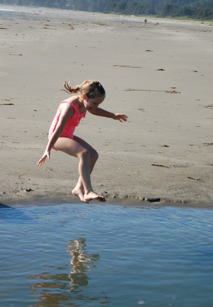 Granddaughhter Olivia (Livvy) leaps into a tidal pool on the beach