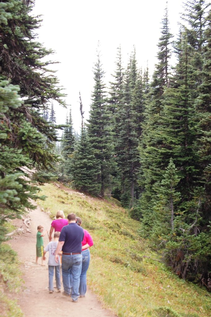 Family all walking along the trail from Tipsoo Lake