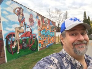 Sumoflam at MrDHEO's wall painting in Lexington, one of a few new PRHBTN murals