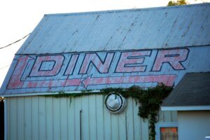 Midway Diner sign on a barn