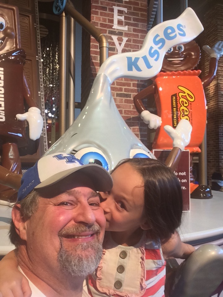 Joselyn gives Grampz a Hershey Kiss