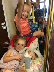 The kids hitched a ride on the luggage rack....
