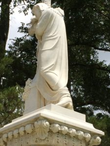 "The famed ""Jesus in Cowboy Boots"" monument at Evergreen Cemetery in Paris, TX"