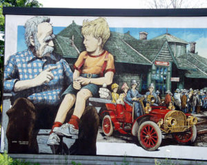 Mural of Grandfather telling stories about Welland to Grandson