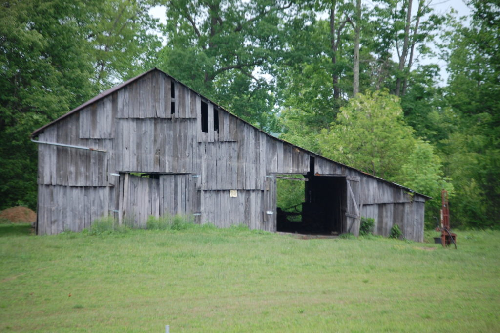 An old barn on the side of the highway. There are dozens of these.