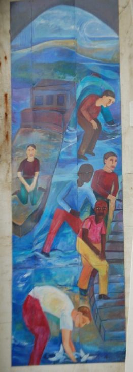A portion of three murals under a bridge in Cleveland