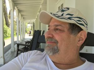 Chillaxin' on the porch of Boston Store in a nice rocking chair