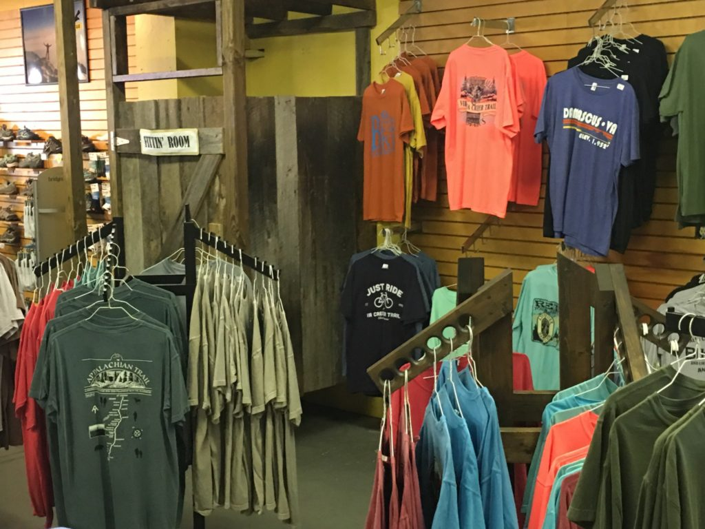 A variety of t-shirts and other amenities at SunDog Outfitters
